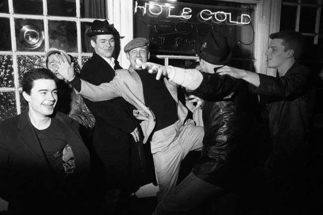 "Madness with their first full length feature film, ""Take It or Leave It"", described as a documentary with music. The film features band members (pictured not in order), Bedders, Chas, Chrissy Boy, Lee, Mike, Suggs and Woody as themselves. Other parts are in the hands of actors. Take It or Leave It is titled after a track from the band's top twenty album."