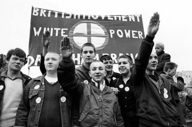 Members of the British Movement hold up a banner with 'White Power' and give Nazi salutes, during a march from Hyde Park, London, to Paddington Recreation Ground. The British Movement is a splinter group of the National Front.