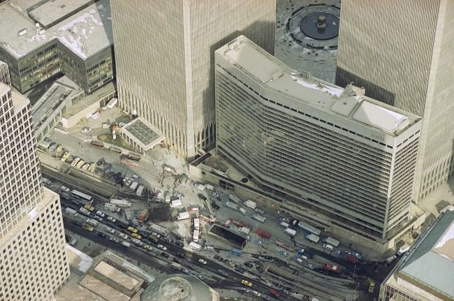 Manhattan's West Street is jammed with police and emergency service vehicles in the aftermath of yesterday's explosion that rocked New York's World Trade Center's twin towers and the Vista Hotel, foreground right, Feb. 27, 1993, causing evacuation of the financial center. Officials all but confirmed that a bomb caused the huge blast that left at least five people dead and injured hundreds.