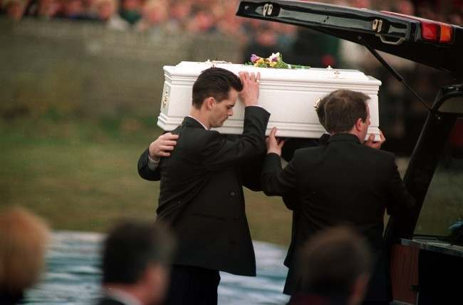 Ralph Bulger carries the coffin of his 2-year-old son, James, into the Church of the Sacred Heart, Kirby. Date: 01/03/1993