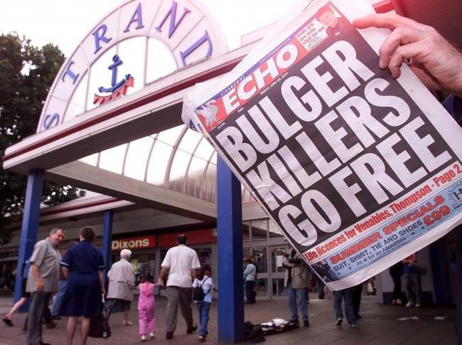 Local people read about the release of the killers of James Bulger in the Liverpool Echo newspaper, outside the Strand shopping centre in Bootle from where James was abducted by Venables and Thompson. The killers of toddler Jamie Bulger were preparing to be released. *The Parole Board ruled that they should go free. The board ruled that Robert Thompson and Jon Venables, now aged 18, were no longer a danger to the public after spending eight years in secure accommodation. But the decision has sparked anger among campaigners who wanted the pair to serve longer sentences. Date: 23/06/2001