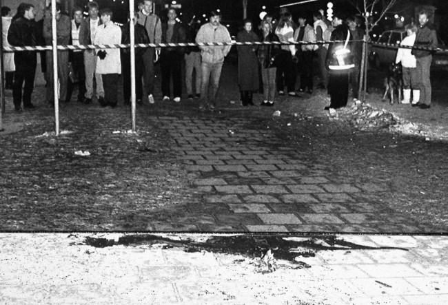 A bouquet of flowers is laid down at the pool of blood on a Stockholm City pavement where Swedish Prime Minister Olof Palme was assassinated shortly before midnight on Friday, Mar. 1, 1986 in Stockholm.