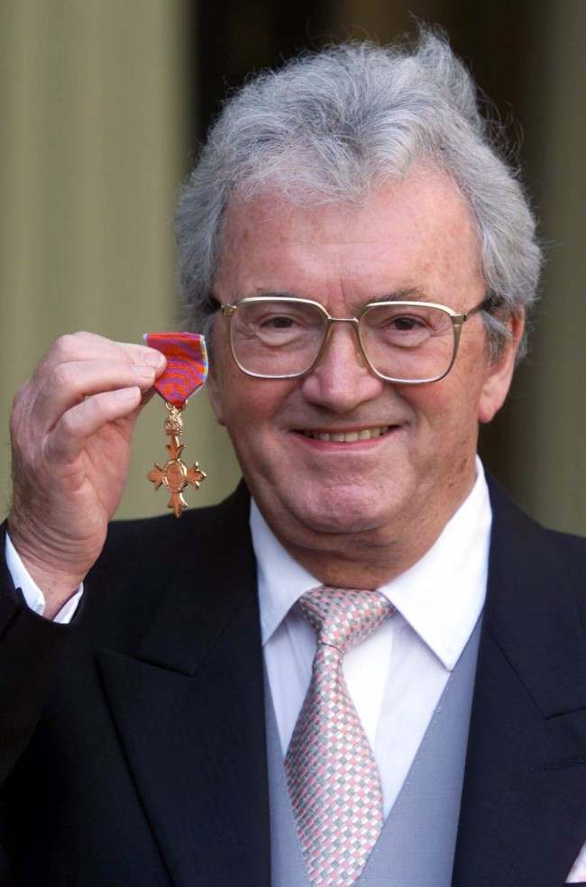 Composer Leslie Bricusse, who wrote Goldfinger for the James Bond film, after receiving his OBE from the Queen Elizabeth II at Buckingham Palace investiture cermony. Mr Bricusse received an OBE for services to the film industry and the theatre.