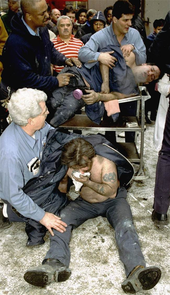 In this file photo of Feb. 26, 1993, Victims of a fire at the World Trade Center in New York are treated at the scene after an explosion rocked the complex. Twenty years ago a group of terrorists blew up explosives in an underground parking garage under one of the towers, killing six people and ushering in an era of terrorism on American soil.