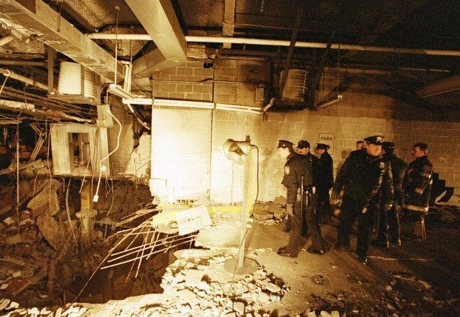 In this file photo of Feb. 27, 1993, police and firefighters inspect the bomb creater inside an underground parking garage of New York's World Trade Center the day after an explosion tore through it. Twenty years ago a group of terrorists blew up explosives under one of the towers, killing six people and ushering in an era of terrorism on American soil.