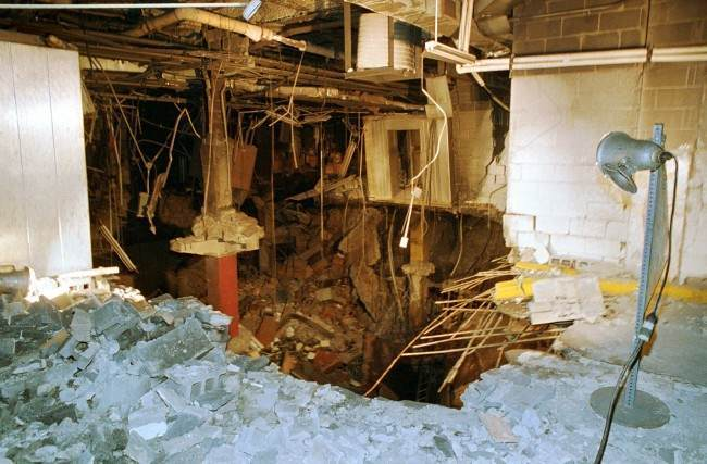 n this file photo of Feb. 27, 1993, a crater is exposed in an underground parking garage of New York's World Trade Center the day after an explosion tore through it. Twenty years ago a group of terrorists blew up explosives under one of the towers, killing six people and ushering in an era of terrorism on American soil.