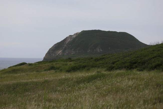 Mt. Suribachi, is seen from Invasion Beach on Iwo Jima, Japan, Friday, June 7, 2013. Iwo Jima, now known officially as Ioto, one of the most iconic battlegrounds of WWII, is today inhabited only by Japanese troops, and is used by the U.S. military for training.