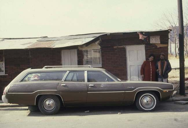 Shirley and Emuel Benton stand in front of the tarpaper shack they and their five children constructed in the Fort Greene section of Brooklyn, N.Y., Nov. 25, 1980. The Bentons, who were evicted from the housing project across the street after Emuel had to go on disability, lived in their station wagon while building their tiny home.