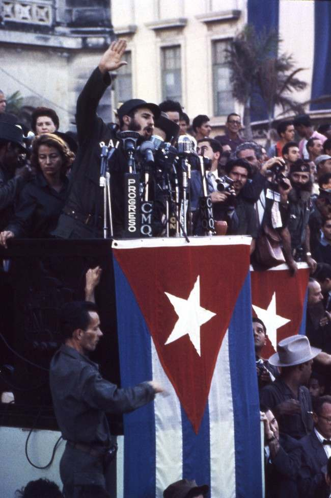 "Rebel leader Fidel Castro gestures as he makes a point as he speaks into a battery of microphones in Havana, Cuba on Jan. 21, 1959 during rally in front of the Presidential Palace, called to back the government's policy executing ""war criminals."""