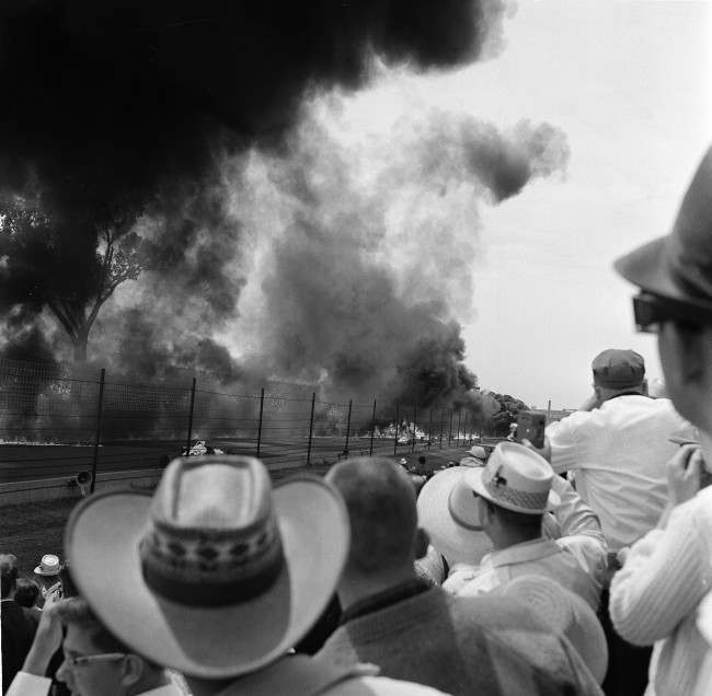 Smoke from burning fuel blankets area around the fourth turn of Indianapolis Speedway, May 30, 1964 in wake of crash and fire involving several cars.