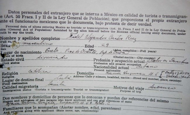 A 1955 Mexican migration document of Cuba's revolutionary leader Fidel Castro is on display as part of the National Institute of Migration exhibit marking the organization's 20th anniversary, in Mexico City, Tuesday, Nov. 5, 2013. Castro, according to historians, used his time in Mexico to organize the group of rebels who took a boat to Cuba in 1956 to launch the rebellion against dictator Fulgencio Batista. The exhibit of 16 notables that include Castro, Russian Marxist revolutionary Leon Trotsky and Nicaraguan guerrilla leader Augusto Cesar Sandino, is a sample of the nearly 500,000 records that make up the institute's archive.