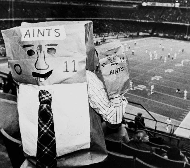 A New Orleans Saints fan wears a bag over his head pointing out the teams 0-11 record this season during game with the Los Angeles Rams in the Superdome in New Orleans, Nov. 24, 1980.