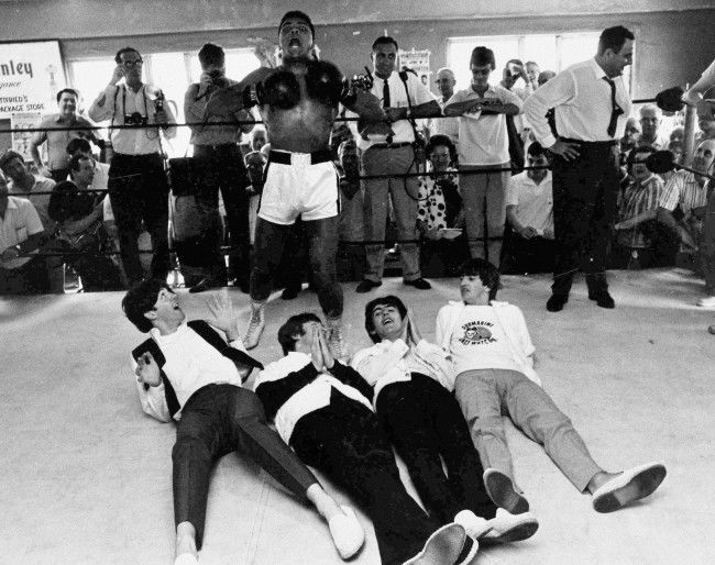 - In this Feb. 18, 1964 file photo, Cassius Clay poses with The Beatles, from left, Paul McCartney, John Lennon, George Harrison and Ringo Starr while visiting the heavyweight boxing contender at his training camp in Miami Beach, Fla. A few days earlier the group had appeared for the first time on the Ed Sullivan Show. A week later, Clay would beat Sonny Liston and go on to even greater things as Muhammad Ali.