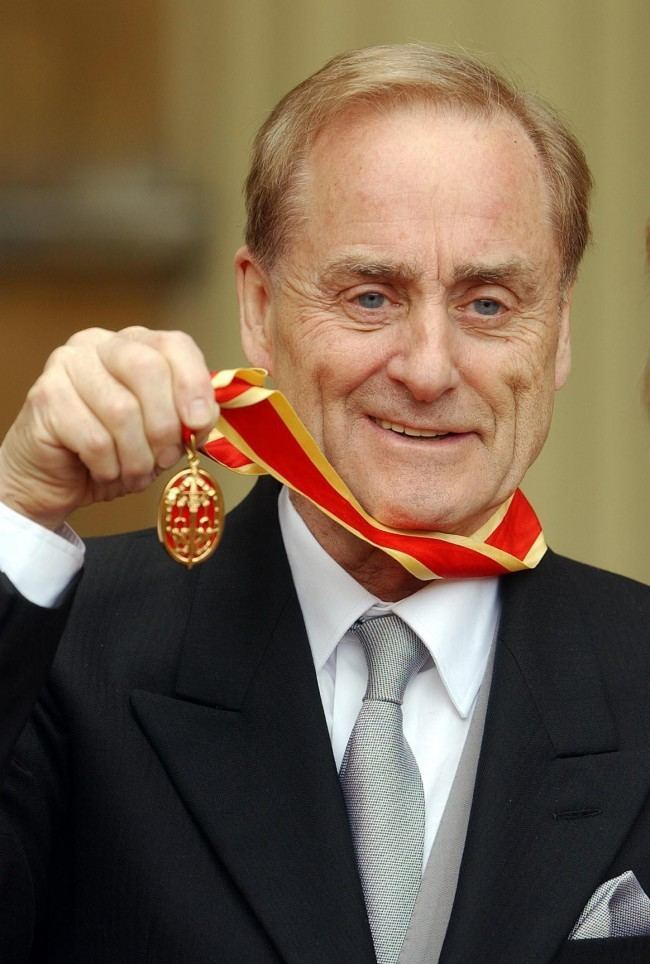 Sir Harold Evans at Buckingham Palace in London, after he was knighted by the Prince of Wales for service to journalism. The son of a railway worker, Sir Harold rose through the ranks to become editor of the Northern Echo and was in charge of the Sunday Times when it reported on the effect of the drug thalidomide on pregnant women.