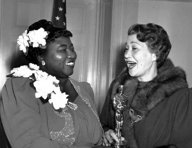 "Hattie McDaniel, left, was given the Motion Picture Academy award for the best performance of an actress in a supporting role in 1939 for her work as ""Mammy"" in the film version of ""Gone With the Wind"" on Feb. 29, 1940 in Los Angeles, Calif. The presentation of the award was given by actress Fay Bainter, right."