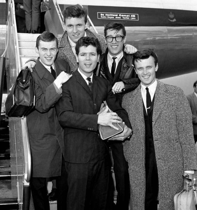 Pop singer Cliff Richard and members of his supporting instrumental band The Shadows at London Airport as they are about to fly off on their Scandinavian Tour. Date: 15/08/1961
