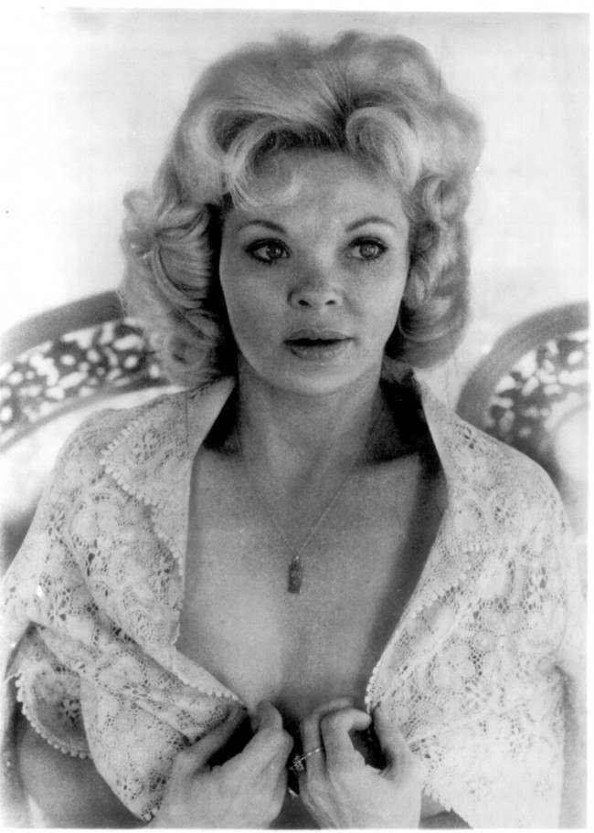 1975 file photo of Candy Barr, a well-known exotic dancer from the 1950s who died Friday, Dec. 30, 2005 at a Victoria hospital. She was 70. Barr, who was born Juanita Dale Slusher on July 6, 1935, in Edna, Texas, was associated with Dallas nightclub owner Jack Ruby, who was accused of gunning down Lee Harvey Oswald, the man suspected of assassinating President Kennedy.
