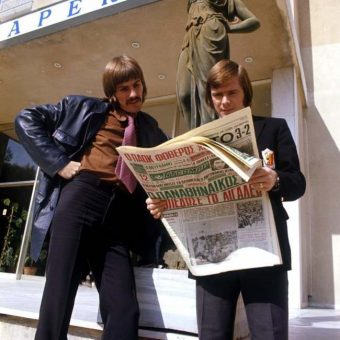 November 1972: Liverpool's Steve Heighway And Brian Hall Read A Greek newspaper in Athens
