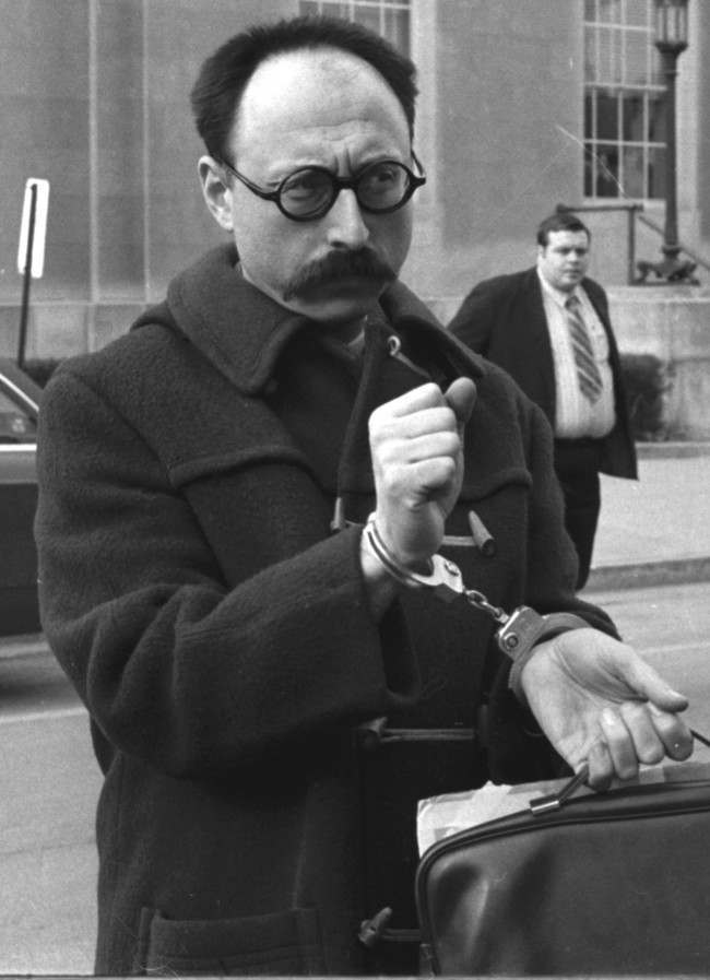 ** FILE **Ralph Ginzburg wears handcuffs outside the federal building in Lewisburg, Pa., in a Feb. 17, 1972, file photo. He was being taken to prison after being convicted on charges of sending obscene literature through the mails. Ginzburg, a magazine publisher who was at the center of two First Amendment battles in the 1960s, tangling with Barry Goldwater and serving eight months in federal prison for obscenity, died Thursday, July 6, 2006. He was 76.