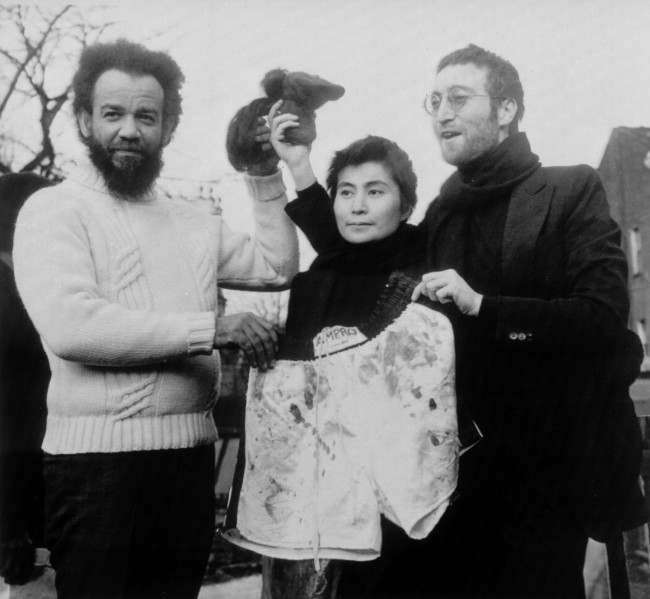 John Lennon and his wife Yoko Ono give some of their shorn hair to Abdul Malik, British Black Muslim leader, in London, Feb. 4, 1970. In exchange, Malik presents the Lennons with a pair of boxer's shorts he said were given to him by fomer world heavyweight boxing champion Muhammad Ali. Malik said the hair would be auctioned to the highest bidder.
