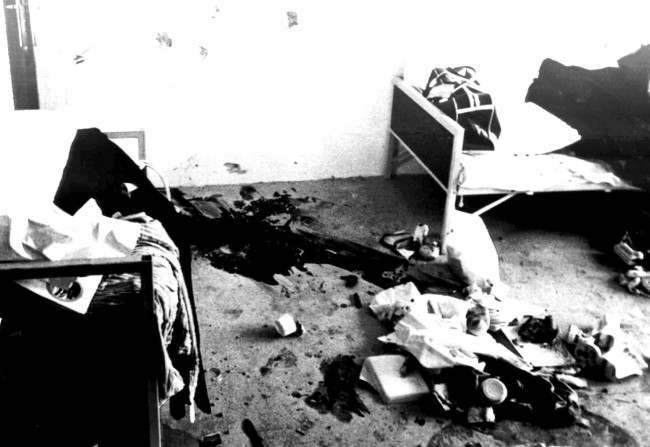 Blood stains and bullet holes mark the place where the Israeli weightlifter Moshe Romano was killed Sept.7, 1972 by Arab commandos inside the Israeli Olympic team's quarters at the Olympic Vilalge in Munich,West Germany. Photo shows the room where eight Israeli athletes were kept hostage for 18 hours. (AP Photo/str)