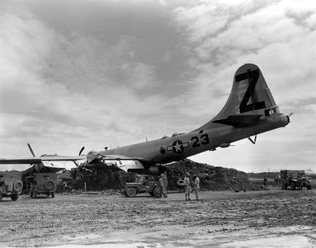 A B-29 Superfortress rests on a dirt mound after it crash landed with two engines working at Iwo Jima, Japan, on April 21, 1945 during World War II. The U.S. Air Force plane was damaged in a raid over Tokyo.