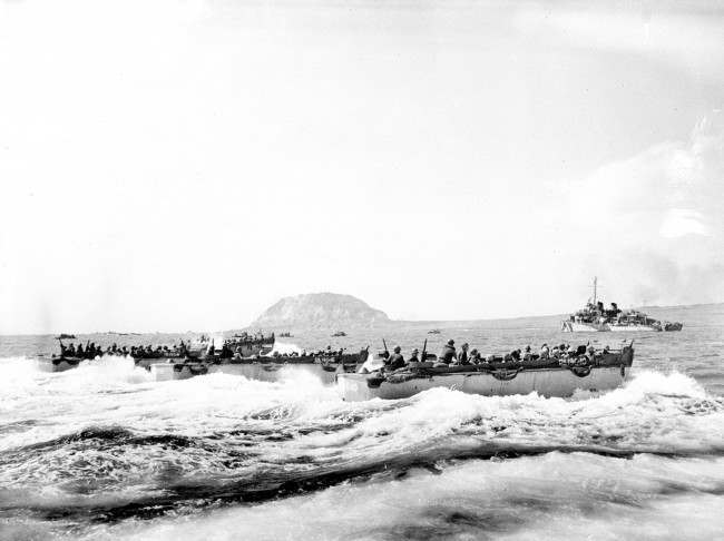 U.S. Marines aboard a landing craft head for the beaches of Iwo Jima Island, Japan, on Feb. 19, 1945 during World War II. In the background is Mount Suribachi, the extinct volcano captured by the Marines after a frontal assault.