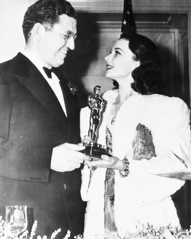 "British actress Vivien Leigh, holding her Oscar, which she won for Best Actress for her role in the film ""Gone With The Wind"", talks to American film producer David O. Selznick, at the banquet of the Academy of Motion Pictures, Arts and Sciences, in Hollywood, Calif., on Feb. 29, 1940. Selznick also won a special award for the same film."