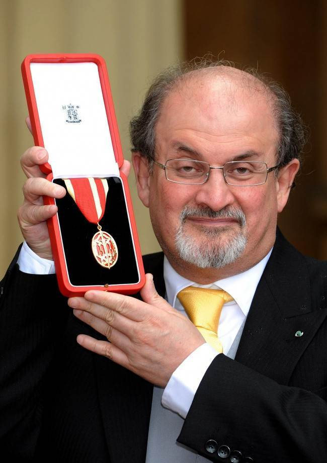 on this day in photos orders salman rushdie to be murdered author sir salman rushdie after receiving his knighthood from queen elizabeth ii during an investiture ceremony
