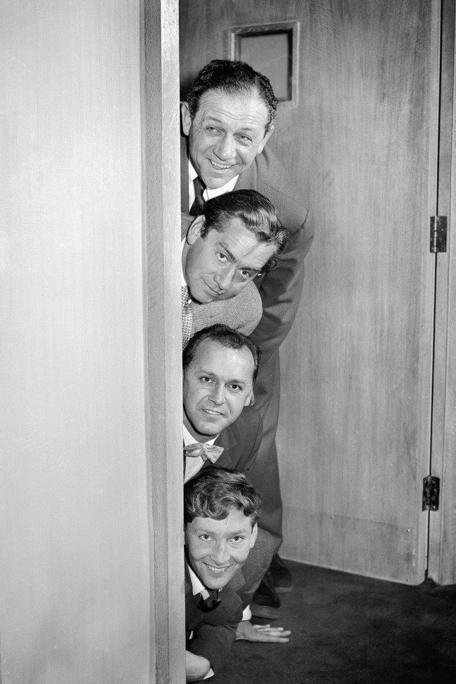 "Top to bottom: Sid James, Tony Hancock, Bill Kerr and Kenneth Williams during rehearsals for the BBC Radio comedy series, ""Hancock's Half Hour"". Date: 09/10/1956"