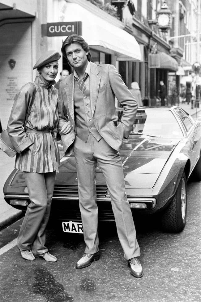 ucci Autumn and Winter Collection - 1980 Oliver, right, wearing a Nappa leather and velour suit. Christa, left, in a suit of similar fabrics.