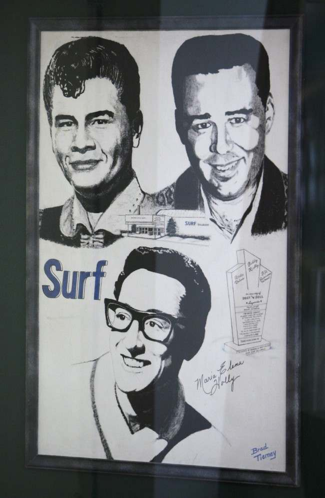 "A poster showing Buddy Holly, Ritchie Valens and J.P. ""The Big Bopper"" Richardson."
