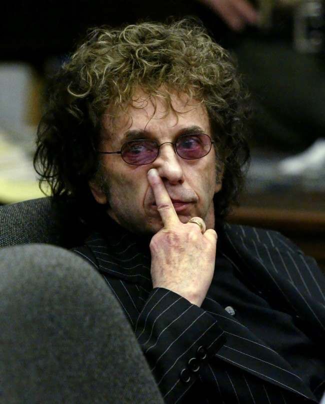 Music producer Phil Spector gestures as he looks at deputy district attorney Douglas Sortina address Alhambra Superior Court judge Carlos Uranga during a hearing Friday, May 7, 2004, in Alhambra, Calif.