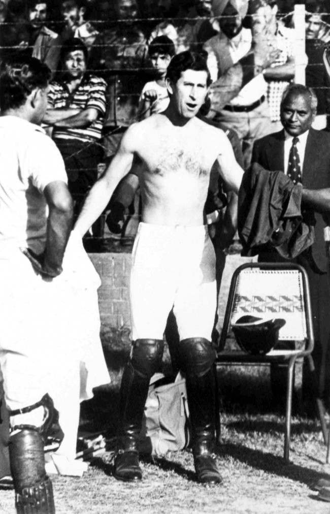 Britain's Prince Charles changes his shirt at the end of a polo match in New Delhi, India, on Nov. 26, 1980.