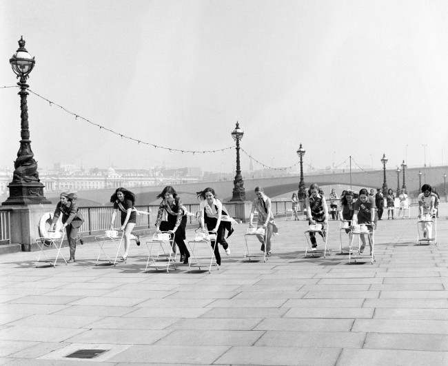 Finalists of the Miss London Stores contest race for the title of 'Festival Trolley Dolly' on the South Bank. The race was 100 yards sprint along the embankment pushing a trolley laden with Wedgewood bone china, claimed to be unbreakable. Before the more serious business of choosing Miss London 1970. Date: 05/05/1970