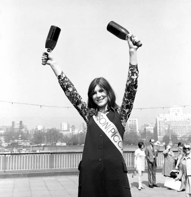 A finalist of the Miss London Stores contest race for the title of 'Festival Trolley Dolly' on the South Bank. The race was 100 yards sprint along the embankment pushing a trolley laden with Wedgewood bone china. Before the more serious business of choosing Miss London 1970. Date: 05/05/1970