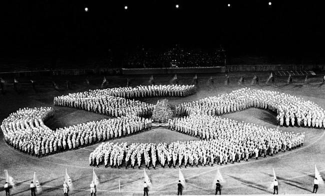 This Associated Press photo shows the Swastika, during rehearsals at Berlins stadium, June 20, 1938, Berlin, Germany. The stadium will again will be filled to capacity when the Hitler Youth and the SA are celebrating summer solstice day in the Olympic Stadium, June 21, 1938, Berlin, Germany. Hundreds of SA men will form a torchlight sun wheel in Germany on June 28, 1938. (AP Photo)