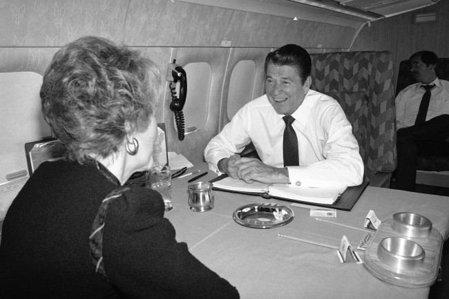President-elect Ronald Reagan and with Nancy relax aboard a twin-engine Air Force jet from the presidential fleet on the way to Washington to meet with congressional leaders on Monday, Nov. 17, 1980 in Washington. Later in the week are scheduled to meet with President Carter and First Lady Rosalynn to the White House.