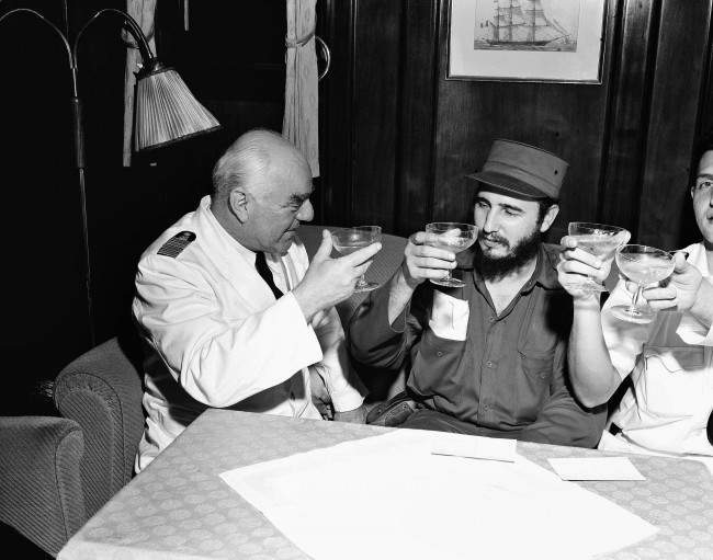 Captain Heinrich Lorenz, left, of cruise ship MS Berlin, proposes a toast to the success of Fidel Castro's government in Cuba, April 15, 1954, Havana, Cuba. Castro visited the North German Lloyd ship after it landed in Havana from New York.