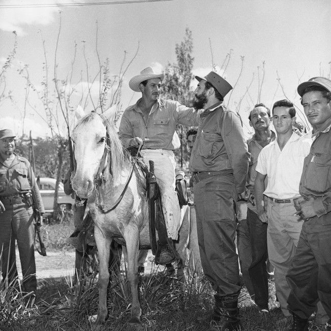 Rebel Leader Fidel Castro stops to talk with a farmer on horseback as he tours the foothills of the Sierra Maestra on Feb. 4, 1959 in Manzanillo, Cuba during a tour of the Eastern part of Cuba that was the cradle of the Revolutionary government. This is one of a series of pictures made by Assocaite Press photographer Harry Harris who spent three days in Oriente province with Castro.