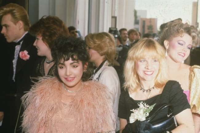 Members of the female rock group the Go-Go's arrive at the 24th Annual Grammy Awards in Los Angeles, Ca., on Feb. 24, 1982. Three of the five group members are Jane Wiedlin, left foreground, Charlotte Caffey, center, and Belinda Carlisle, right.