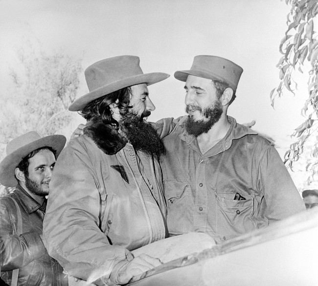 Cuban rebel leader Fidel Castro, right, embraces Camilo Cienfuegos, Revolutionary Army commander, in Santiago, Cuba, Jan. 4, 1959. Cienfuegos is leaving for Havana to take command of the Columbia barracks.