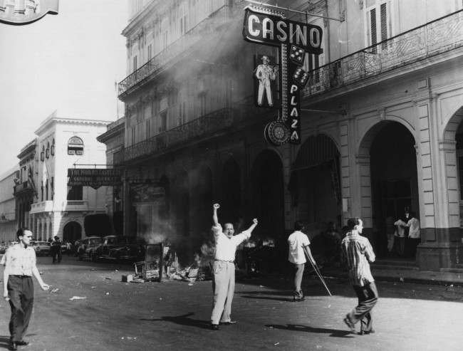 People burn tables and roulette wheels outside the Plaza Hotel casino in Old Havana, Cuba in Jan. 1959