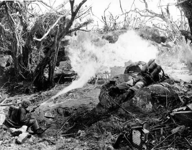 Two U.S. Marines directing flame throwers at Japanese defenses that block the way to Iwo Jima's Mount Suribachi on March 4, 1945 during World War II. On the left is Pvt. Richard Klatt, of North Fond Dulac, Wis., and on the right is PFC Wilfred Voegeli.