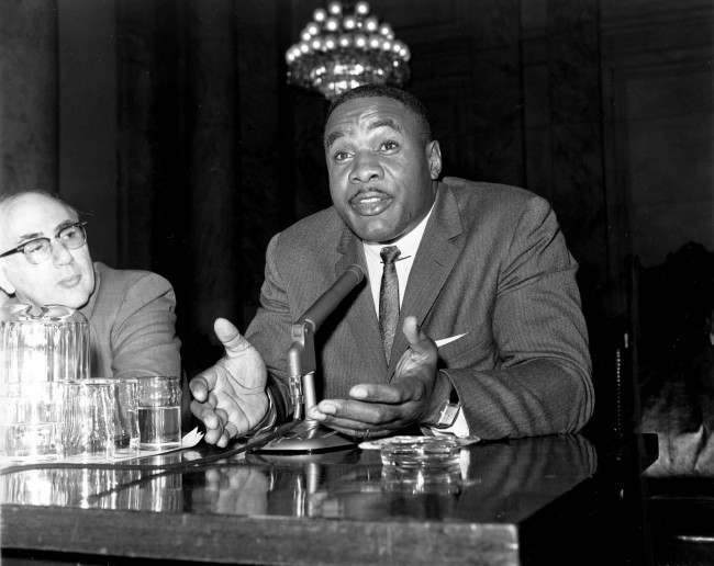 Sonny Liston, heavyweight boxing title contender, speaks from the witness chair at a hearing before a Senate committee probing boxing operations in Washington, D.C., Dec. 13, 1960. Liston's testimony indicated a large share of his earnings goes to mobsters.