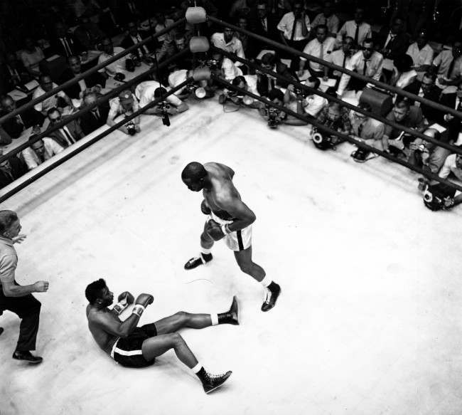 Floyd Patterson is on the ground after world heavyweight champion Sonny Liston staggers with a right then connects with a left for the knock out in Las Vegas, Nev. on July 22, 1963.