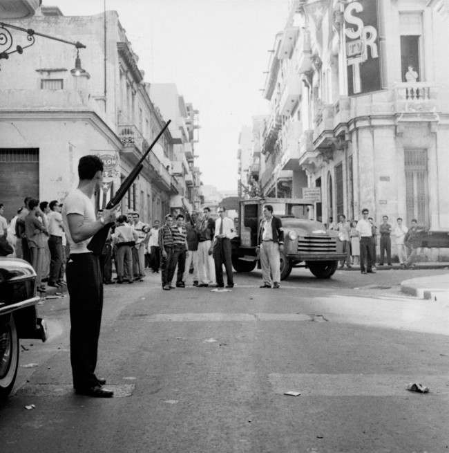 This is a familiar scene throughout Havana today with rebel forces manning road blocks and challenging all persons on the street. Troops of Rebel Leader Fidel Castro moved into downtown Havana, January 2, 1959. Civilians man most of the road blocks.