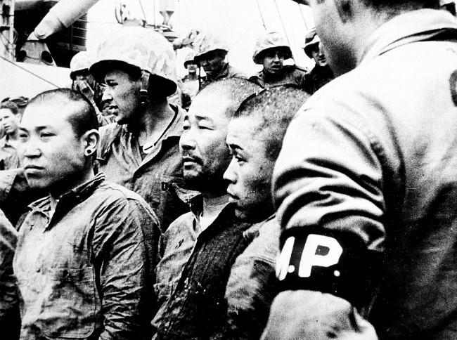 Three Japanese prisoners of war are shown aboard a U.S. Navy vessel in Japan on March 7, 1945 during World War II. They are among the few defenders captured alive on Iwo Jima.