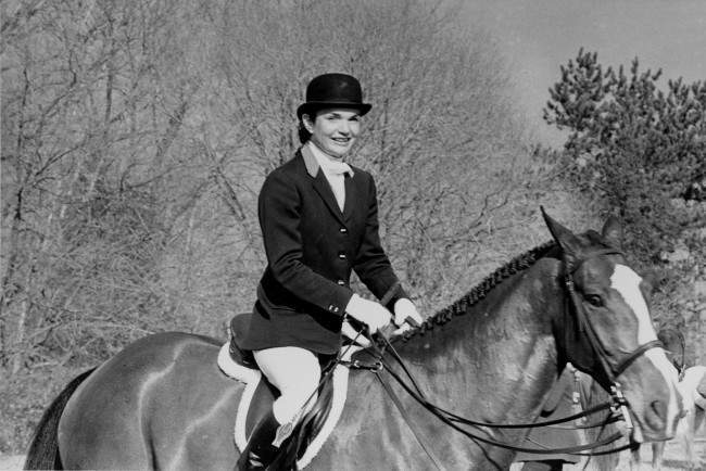 Jackie Onassis rides on horseback in the traditional Essex Fox Hounds Meeting, the annual Thanksgiving Day hunt in Bedminster, N.J., Thursday, Nov. 27, 1980.