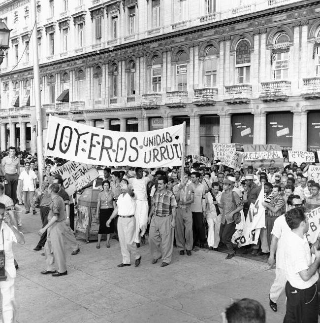Jewelers brought out this big banner at this mass meeting to pledge support Manuel Urrutia, named by Rebel Leader Fidel Castro to be the next President of Cuba. A huge crowd gathered in Central Park expecting to see the new president but was disappointed in Havana, Jan. 2, 1959.